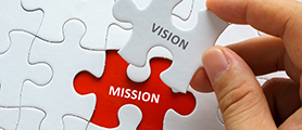 puzzle pieces with Mission, Vision and value all fiting together